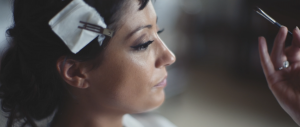 woman getting her wedding makeup done
